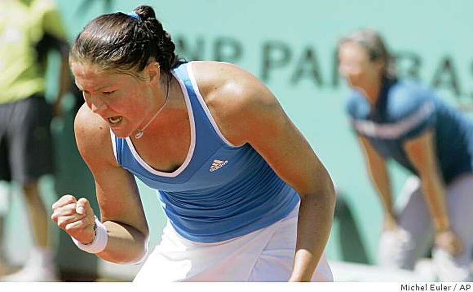 Russia's Dinara Safina jubilates after defeating Slovakia's Dominika Cibulkova during a semifinal match of the French Open tennis tournament at the Roland Garros stadium in Paris, Thursday June 4, 2009. (AP Photo/Michel Euler) Photo: Michel Euler, AP
