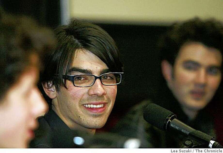 "Joe Jonas (center with glasses) answers questions during a press conference before greeting fans at the Century San Francisco Centre before their movie  ""Jonas Brothers The 3D Concert Experience"" is shown in San Francisco, Calif. on Sunday, March 1, 2009. Photo: Lea Suzuki, The Chronicle"
