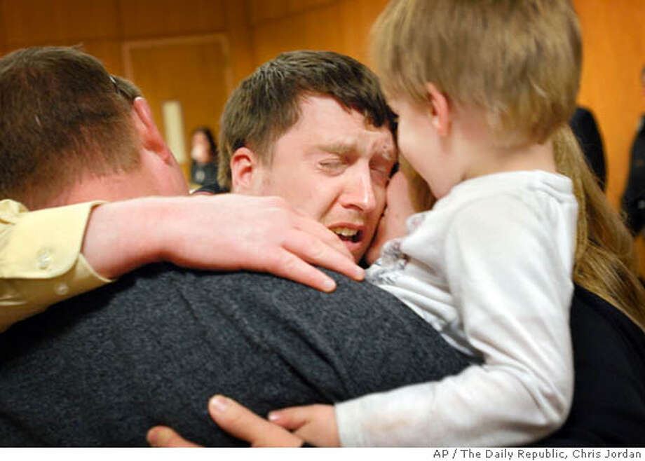David Bell hugs his father David Bell, his stepmother Vonnie Bell and his halfbrother Connor Bell in the Solano County Hall of Justice in Fairfield, Calif., Thursday, Feb. 7, 2008, after a jury found him not guilty on all counts for charges stemming from a car collision that killed two siblings near Padan Elementary School in Vacaville in October 2005. (AP Photo/The Daily Republic, Chris Jordan) **NO SALES, MANDATORY CREDIT** Photo: Chris Jordan