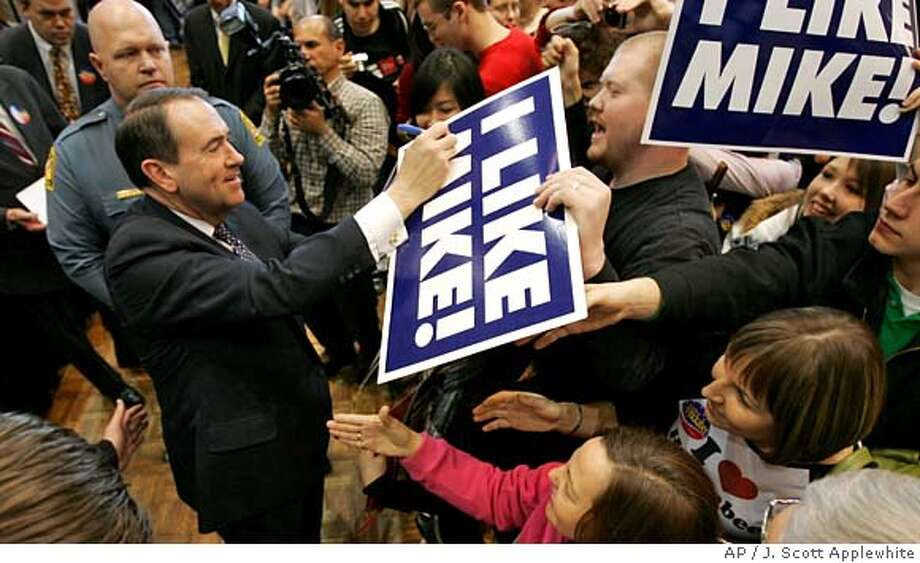 Republican presidential hopeful, former Arkansas Gov. Mike Huckabee, greets students and supporters at a campaign rally at the University of Maryland in College Park, Md., Saturday, Feb. 9, 2008. Maryland, Virginia, and the District of Columbia hold primary elections next Tuesday. (AP Photo/J. Scott Applewhite) Photo: J. Scott Applewhite