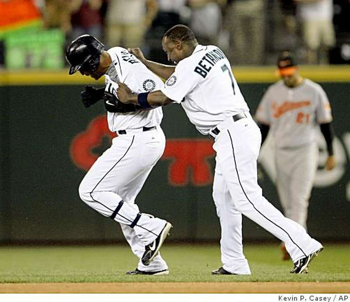 Seattle Mariners' Adrian Beltre, left, is congratulated by teammate Yuniesky Betancourt, after Beltre's game winning single in the bottom of the ninth inning with the bases loaded in a baseball game against the Baltimore Orioles in Seattle, Wednesday, June 3, 2009. Seattle won 3-2. (AP Photo/Kevin P. Casey)