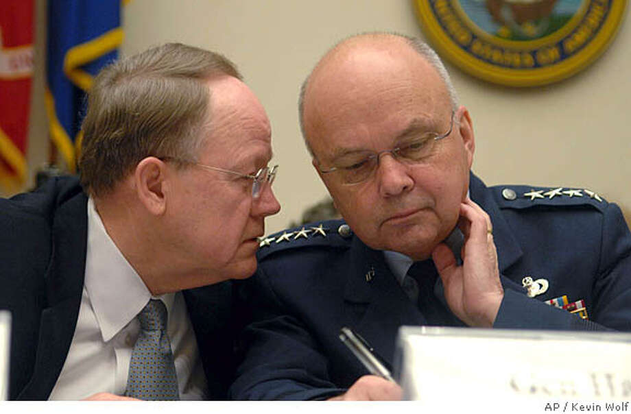 Director of National Intelligence Mike McConnell, left, talks to CIA Director Lt. Gen. Michael Hayden on Capitol Hill in Washington, Thursday, Feb. 7, 2008, during a House Intelligence Committee hearing. (AP Photo/Kevin Wolf) Photo: Kevin Wolf