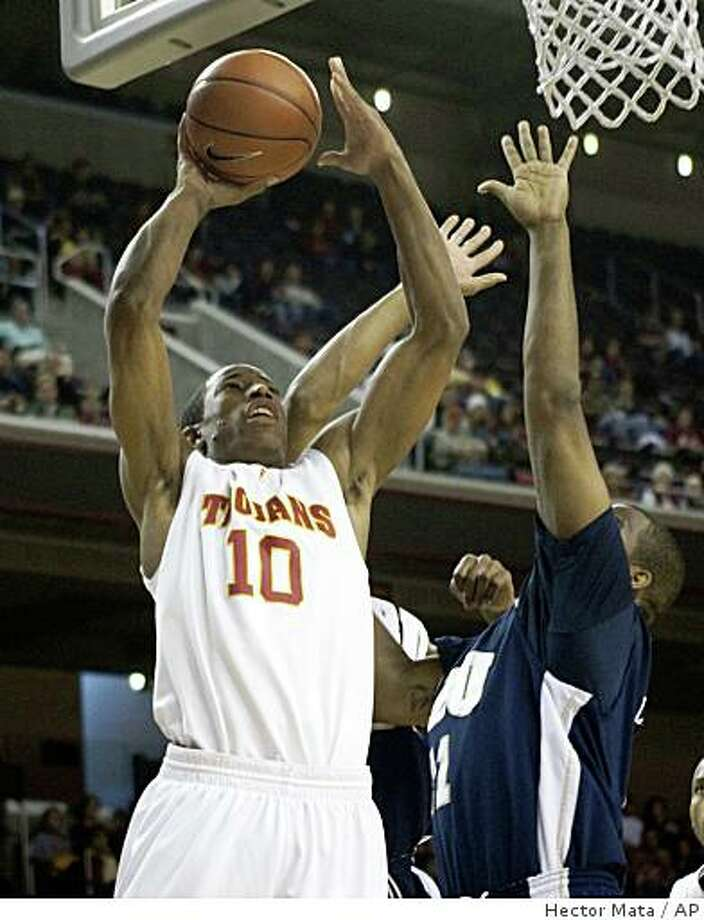 Southern California's DeMar DeRozan shoots over Oral Roberts' Marcus Lewis during the first half of an NCAA college basketball game in Los Angeles on Sunday, Dec. 28, 2008. USC won 66-56. (AP Photo/Hector Mata) Photo: Hector Mata, AP