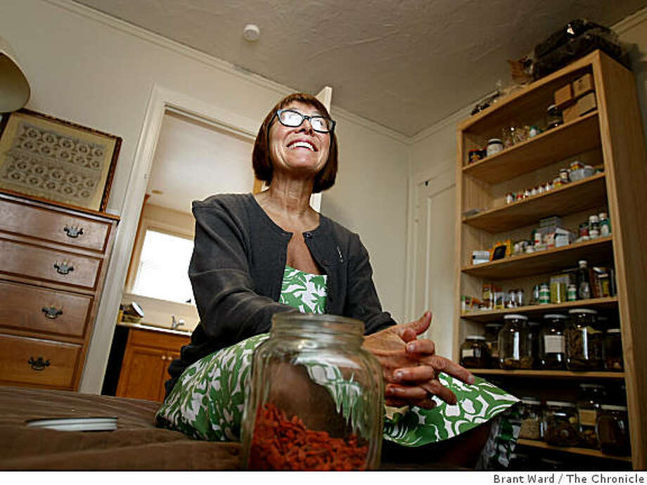 Hale' Tokay smiles as she talks about her life sitting in the room where she does acupuncture and massage. Acupuncturist Hale' Tokay was one of the first Americans to study acupuncture in China after President Nixon normalized relations. Photo: Brant Ward, The Chronicle