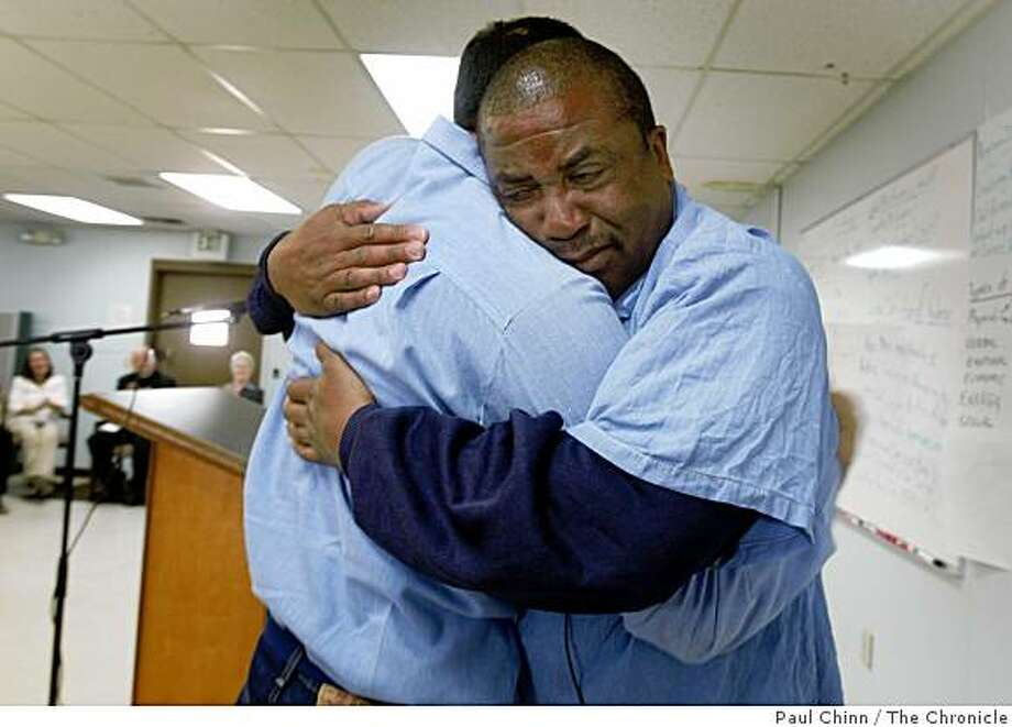 John Phillips, who described his profession as an embalmer, hugged fellow inmate Richard Poma after competing a violence prevention program offered by the Insight Prison Project at the state prison in San Quentin, Calif., on Friday, June 12, 2009. Photo: Paul Chinn, The Chronicle