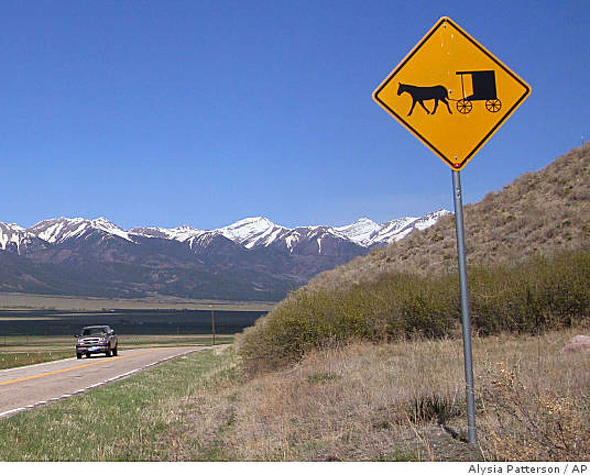 This photo taken on May 13, 2009, shows a sign on Highway 69 just outside of the town of Westcliffe, Colo., that warns motorist to look out for Amish horse-drawn carriages. Westcliffe, population 466, and nearby hamlets like La Jara and Monte Vista are welcoming a growing influx of Amish families drawn westward by cheaper farmland and the serenity and isolation of southern Colorado. (AP Photo/Alysia Patterson)