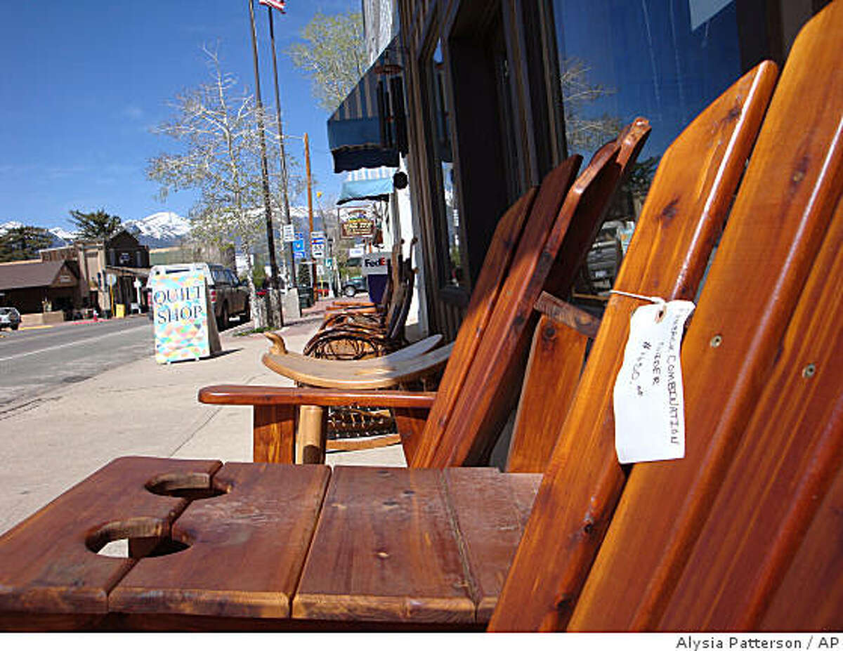 This photo taken on May 13, 2009, shows handmade furniture for sale at Yoder's Mountain View Furniture on Main St. in the of the town of Westcliffe, Colo. Westcliffe, population 466, and nearby hamlets like La Jara and Monte Vista are welcoming a growing influx of Amish families drawn westward by cheaper farmland and the serenity and isolation of southern Colorado. (AP Photo/Alysia Patterson)
