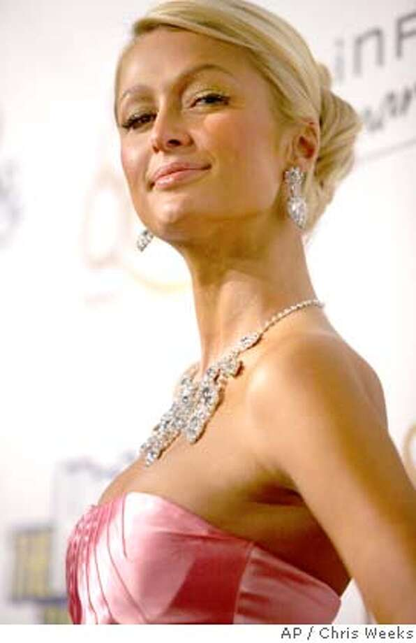 """Actress Paris Hilton arrives at the Los Angeles premiere of """"The Hottie and the Nottie"""" in the Hollywood section of Los Angeles Monday, Feb. 4, 2008. (AP Photo/Chris Weeks) Photo: CHRIS WEEKS"""