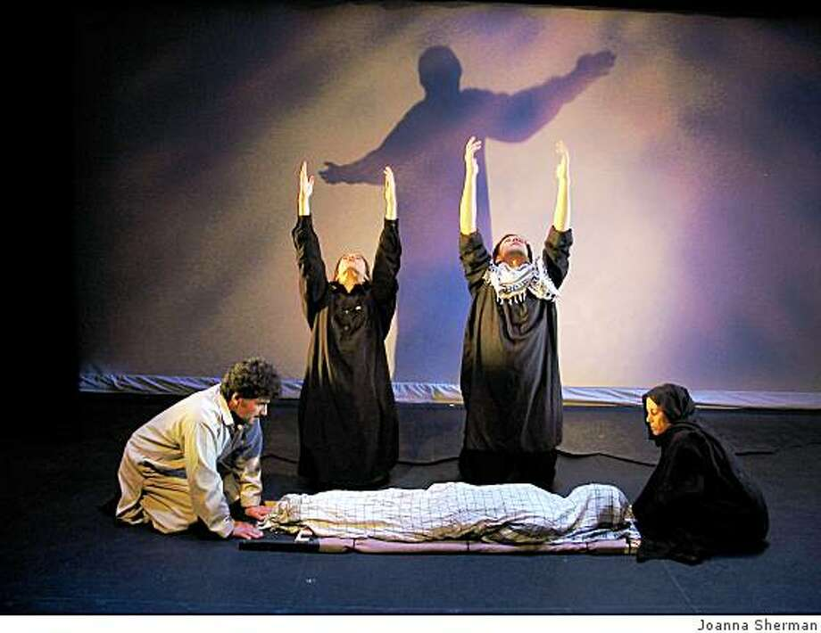 """Jamil Royesh (left), Christina Gelsone, Matt Schmidt and Anisa Wahab in """"Beyond the Mirror,"""" a collaboration between Exile Theatre of Kabul and New York's Bond Street Theatre Photo: Joanna Sherman"""