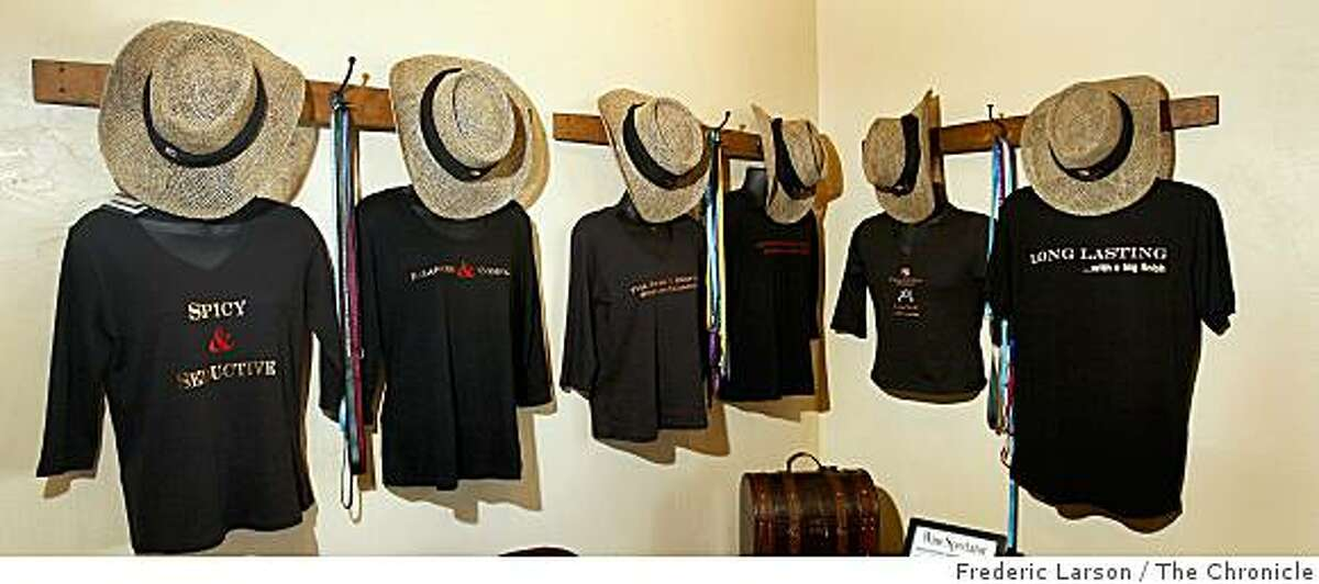 Cowboy hats and shirts that are for sale are hung up at the Papapietro Perry, 4791 Dry Creek Road, Healdsburg.