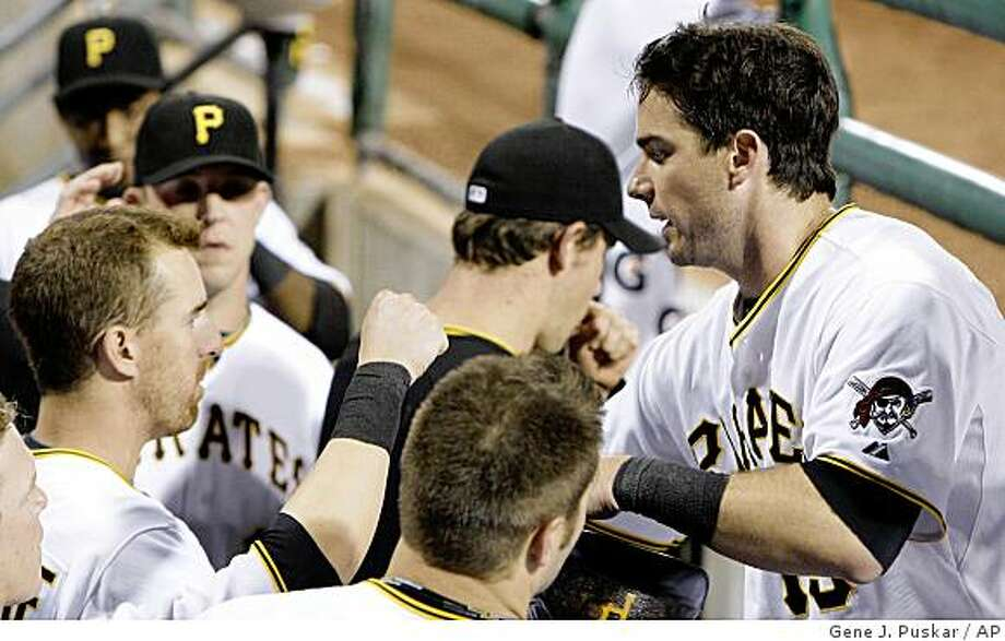 Pittsburgh Pirates' Andy LaRoche, right, celebrates with teammates, including his brother Adam LaRoche, left, after scoring the tying run in the eighth inning against the New York Mets in a baseball game in Pittsburgh on Monday, June 1, 2009. The Pirates won 8-5. (AP Photo/Gene J. Puskar) Photo: Gene J. Puskar, AP