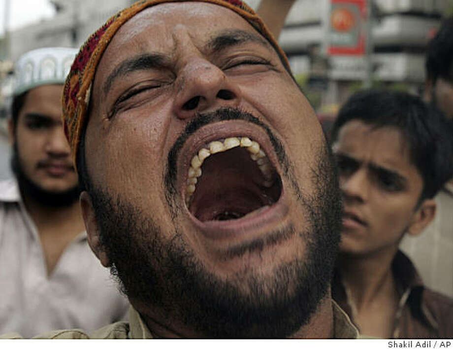 A Pakistani protester reacts over a killing of prominent Pakistani religious cleric by a suicide attacker, during a protest rally in Karachi, Pakistan, Friday, June 12, 2009. Suicide bombers attacked a mosque and a religious school within minutes Friday in two Pakistani cities, leaving one of the country's most prominent anti-Taliban clerics dead in what authorities called a targeted killing.(AP Photo/Shakil Adil) Photo: Shakil Adil, AP