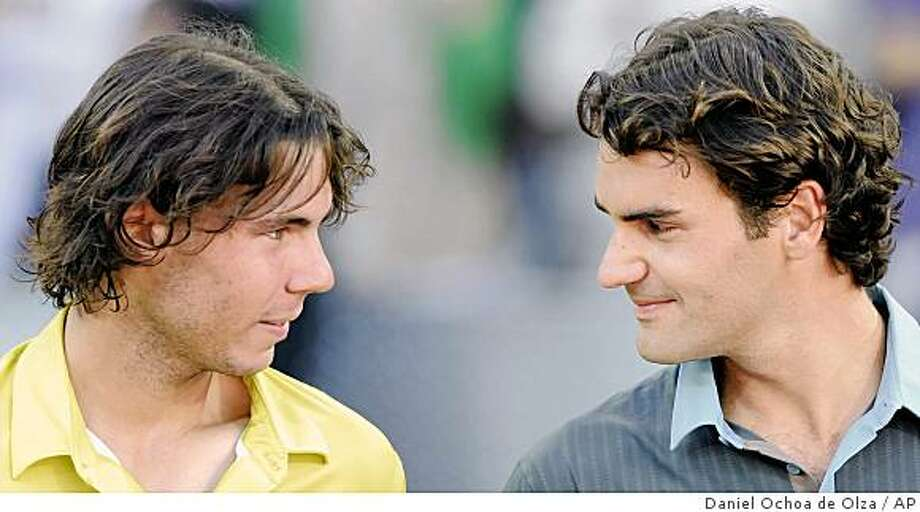 Roger Federer from Switzerland, right,  seen, with Rafael Nadal from Spain, after winning the Madrid Open Tennis Tournament, in Madrid, Sunday May 17, 2009. (AP Photo/Daniel Ochoa de Olza) Photo: Daniel Ochoa De Olza, AP