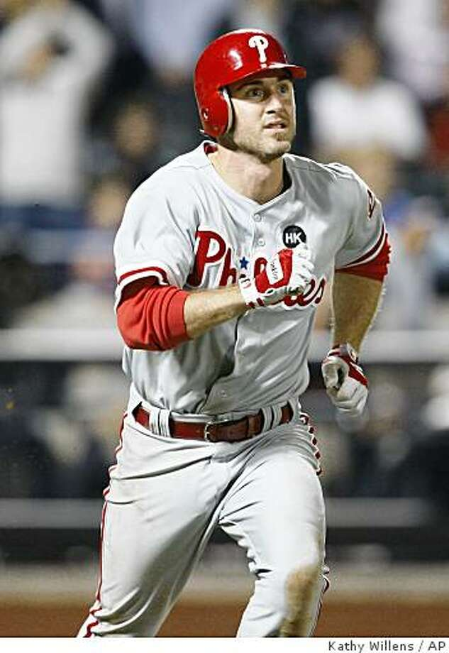 Philadelphia Phillies' Chase Utley watches his 11th-inning solo home run off New York Mets reliever Bobby Parnell in a baseball game at Citi Field in New York, Wednesday, June 10, 2009. (AP Photo/Kathy Willens) Photo: Kathy Willens, AP
