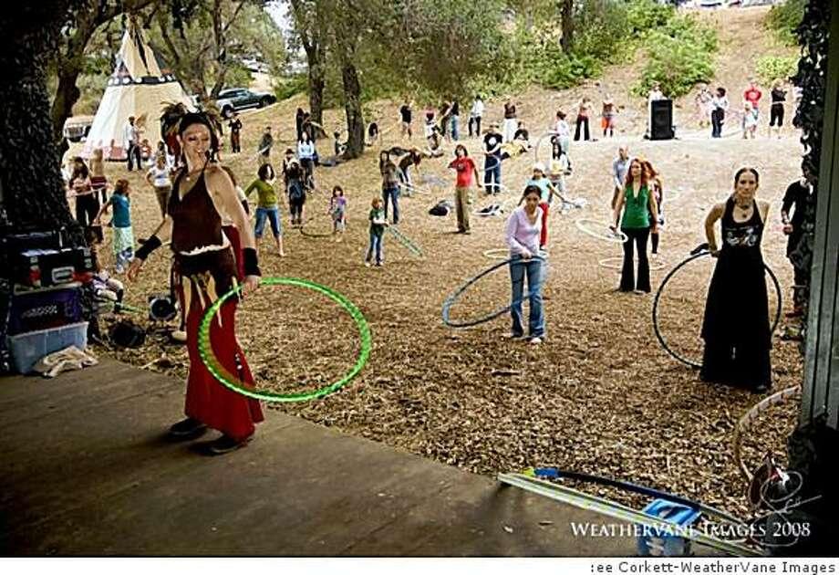 Rosie Masters, aka ?Miss Rosie,? founder of Hero Hoops, leads a hula hooping class. Photo: :ee Corkett-WeatherVane Images