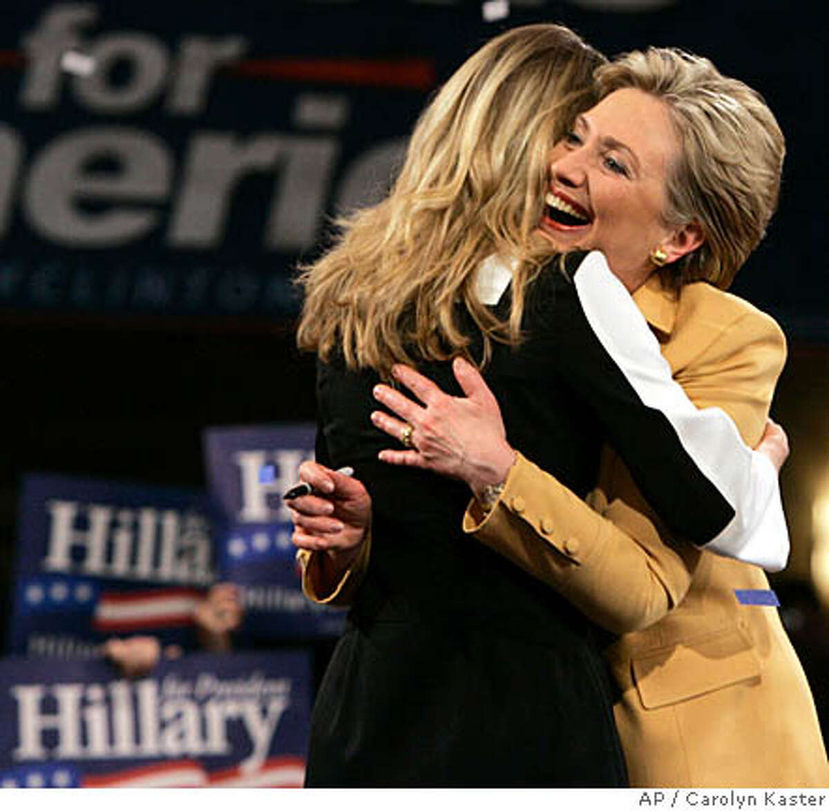 Democratic presidential hopeful Sen. Hillary Rodham Clinton, D-N.Y.,hugs her daughter, Chelsea at her Super Tuesday primary night rally in New York, Tuesday, Feb. 5, 2008. (AP Photo/Carolyn Kaster)