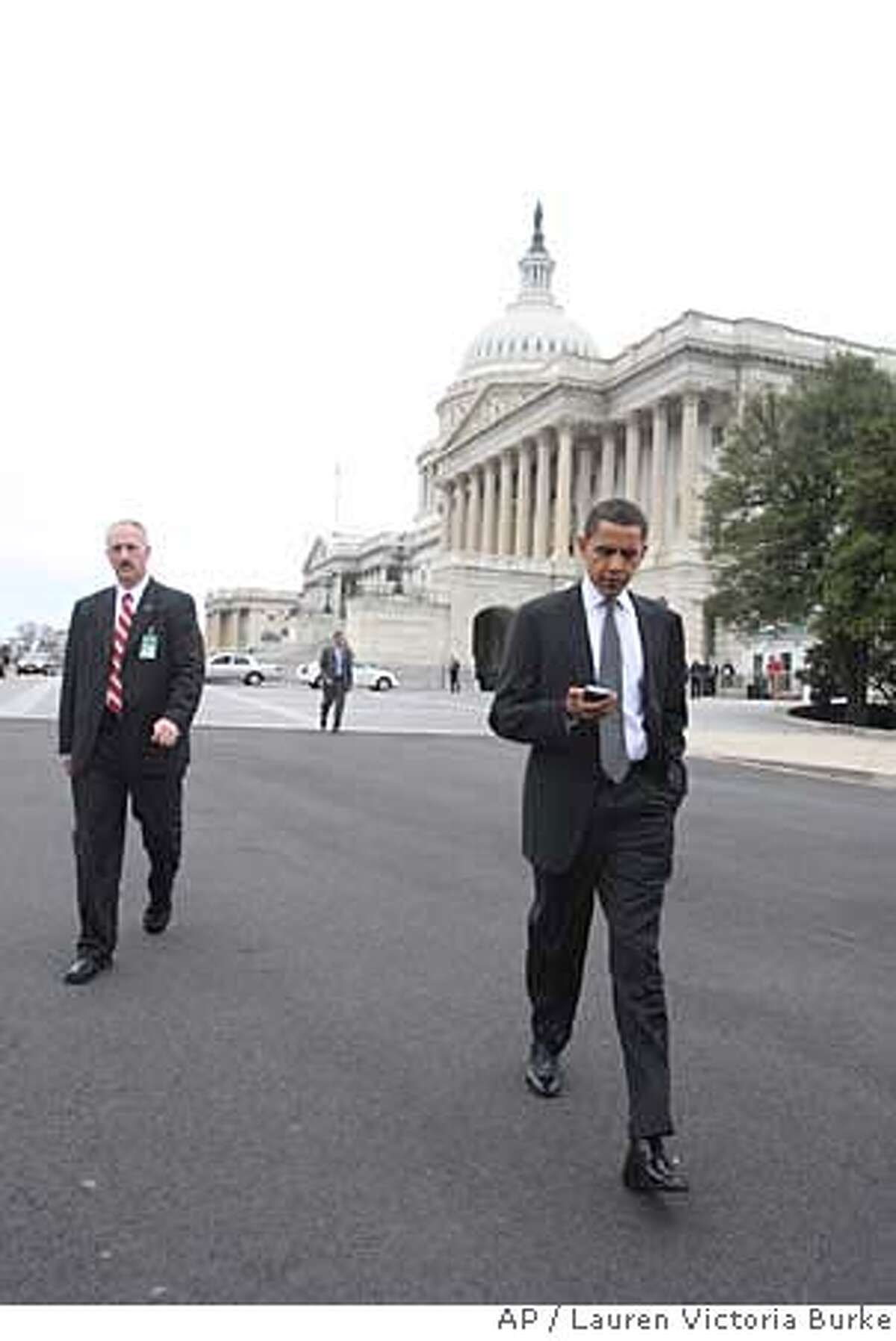 Democratic presidential hopeful, Sen. Barack Obama, D-Ill., walks on Capitol Hill in Washington, Wednesday, Feb. 6, 2008, after voting on an amendment to the Foreign Intelligence Surveillance Act (FISA). (AP Photo/Lauren Victoria Burke)