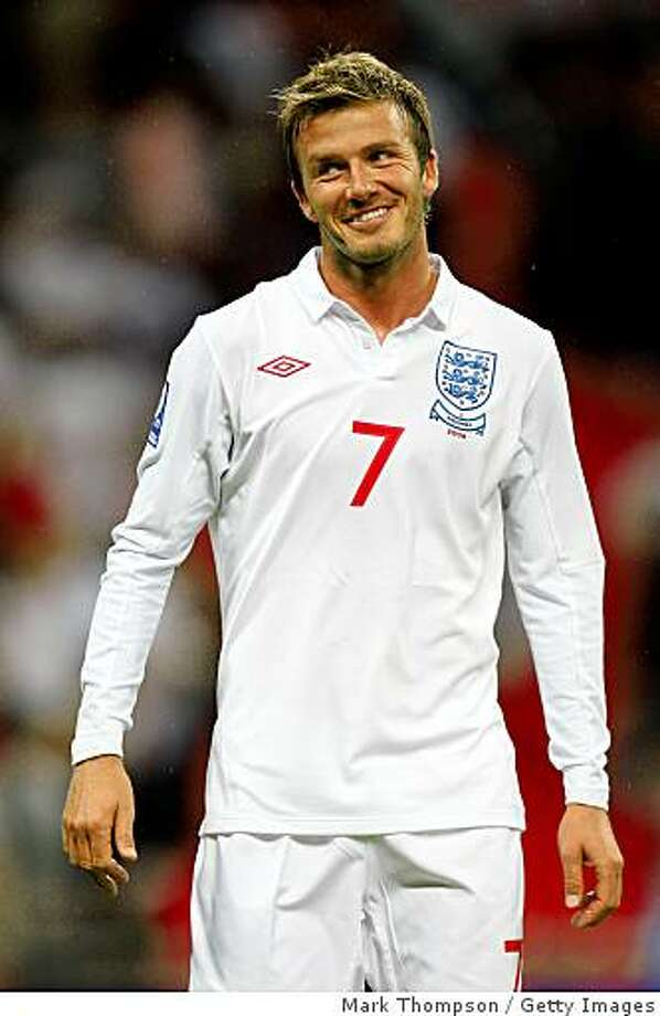 LONDON, ENGLAND - JUNE 10:  David Beckham of England celebrates after victory in  the FIFA 2010 World Cup Group 6 Qualifying match between England and Andorra at Wembley Stadium on June 10, 2009 in London, England.  (Photo by Mark Thompson/Getty Images) Photo: Mark Thompson, Getty Images
