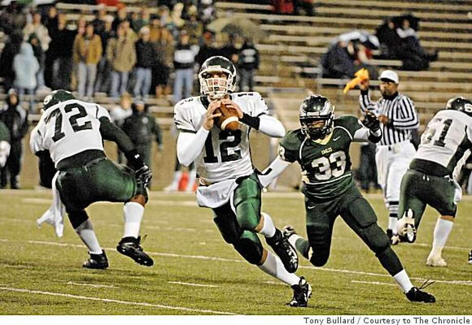 Stratford quarterback Andrew Luck (cq) (#12) scrambles looking for a receiver in the 1st half of the Cypress Falls vs Stratford high school playoff game at the Berry Center 11/24/07.Luck is now a top Stanford recruit. Photo: Tony Bullard, Courtesy To The Chronicle