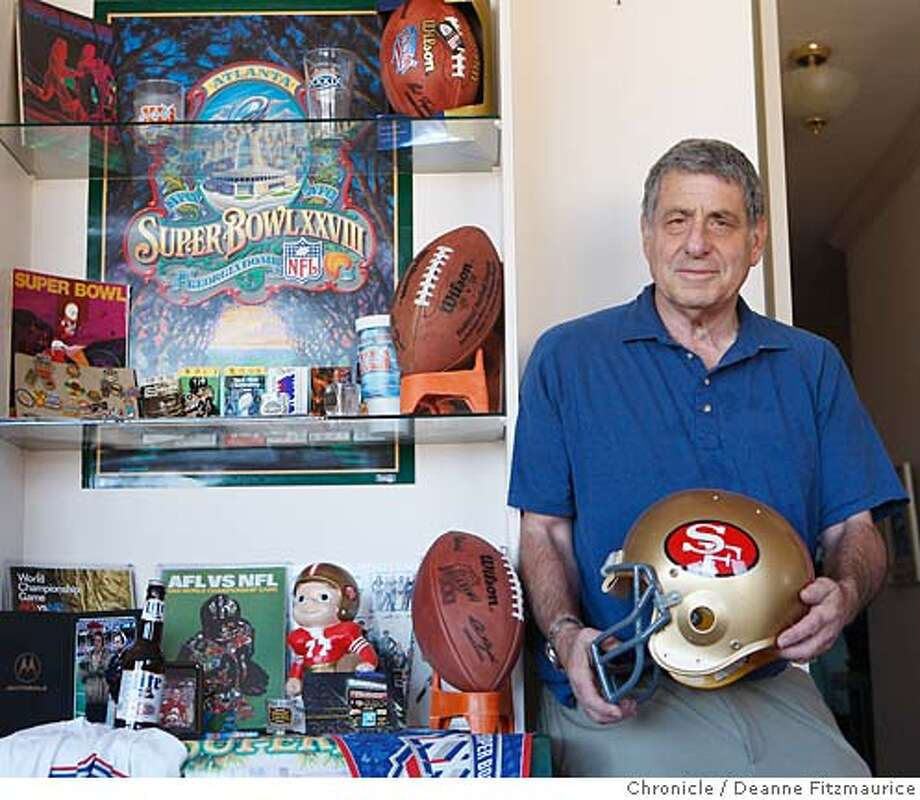 Larry Jacobson has attended every one of the 41 Superbowls. He is photographed in his home with his memorabilia. Photographed in San Francisco on 1/18/08. Deanne Fitzmaurice / The Chronicle Photo: Deanne Fitzmaurice