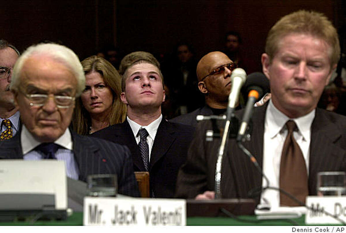Napster founder Shawn Fanning, center, listens as the Senate Judiciary Committee holds a hearing on online entertainment Tuesday, April 3, 2001, on Capitol Hill in Washington. Jack Valenti, president of the Motion Picture Association of America, is at left and recording artist Don Henley is at right. (AP Photo/Dennis Cook)