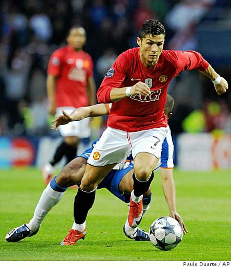 In this Wednesday, April 15, 2009 file photo Manchester United's Cristiano Ronaldo drives the ball against FC Porto in a Champions League quarterfinal second leg soccer match  at the Dragao stadium in Porto, Portugal. Manchester United accepted a world record transfer offer for Cristiano Ronaldo from Real Madrid on Thursday, June 11, 2009  clearing the World Player of the Year to negotiate personal terms with the Spanish club. Photo: Paulo Duarte, AP
