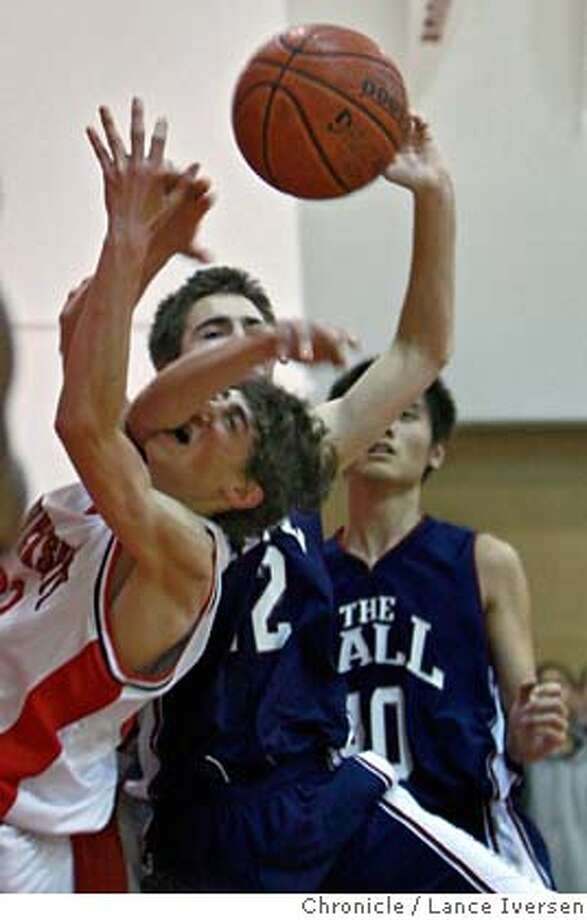 University #32 Noah Springwater gets an elbow to the face as he battles Stuart Hall #42 Frank Duncan for a rebound under Hall basket. University red Devils Vs. Stuart Hall Knights By Lance Iversen/The Chronicle MANDATORY CREDIT PHOTOG AND SAN FRANCISCO CHRONICLE/NO SALES MAGS OUT Photo: Lance Iversen