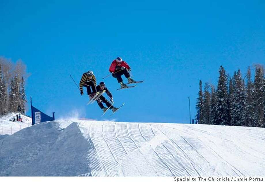 Daron Rahlves, in red, leading the semi-final heat over the last jump at The Jeep King of the Mountain Skier-Cross competition in Telluride, Colorado on December 16, 2007. Behind Rahlves are fellow skier-cross competitors France's Enak Gavaggio, in stripes, and USA's Casey Puckett, in black. Although Rahlves is considered the most winning American World Cup skier ever, he had never finished a skier-cross race prior to this event. �Jaime Porras / Special to the Chronicle. Ran on: 01-27-2008  Daron Rahlves, in red, leads the semifinal heat over the last jump at the Jeep King of the Mountain Skiercross competition Dec. 16 in Telluride, Colo. Behind him is France's Enak Gavaggio in stripes, and USA's Casey Puckett.  Ran on: 01-27-2008 Photo: JAIME PORRAS