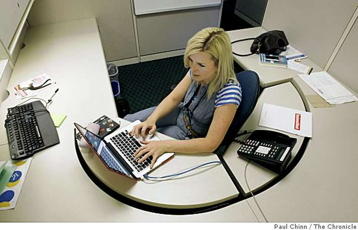 Tara Hunt accesses her Twitter site at her job at Intuit in Mountain View, Calif., on Tuesday, April 21, 2009.