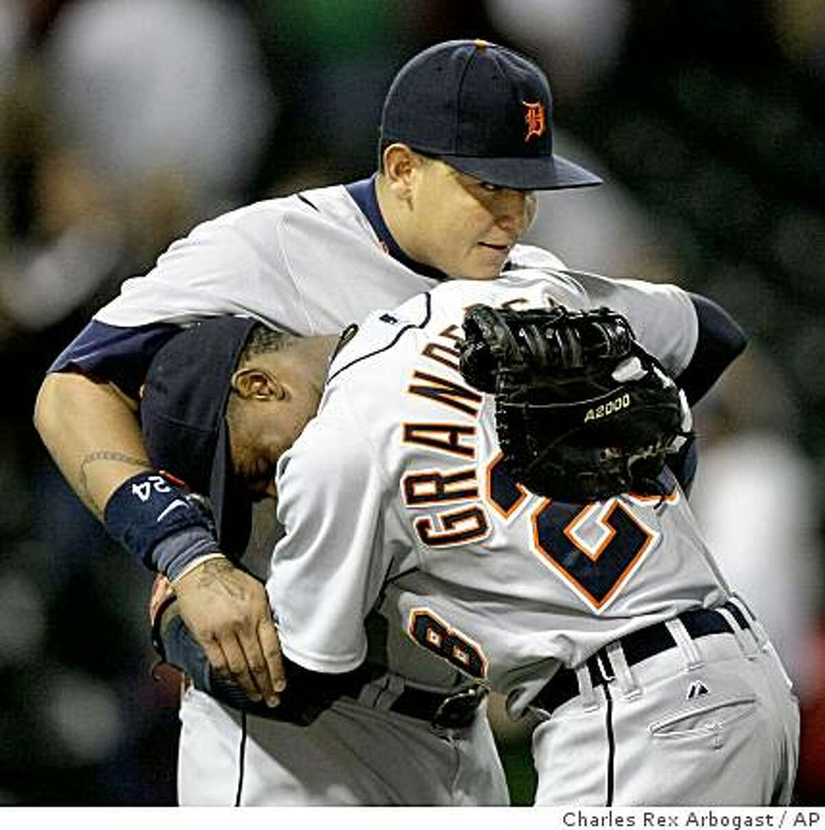 Detroit Tigers' Miguel Cabrera is hugged by Curtis Granderson after the Tigers defeated the Chicago White Sox 7-6 in 10 innings Tuesday, June 9, 2009, in Chicago. Cabrera hit a home run in the 10th inning. (AP Photo/Charles Rex Arbogast)