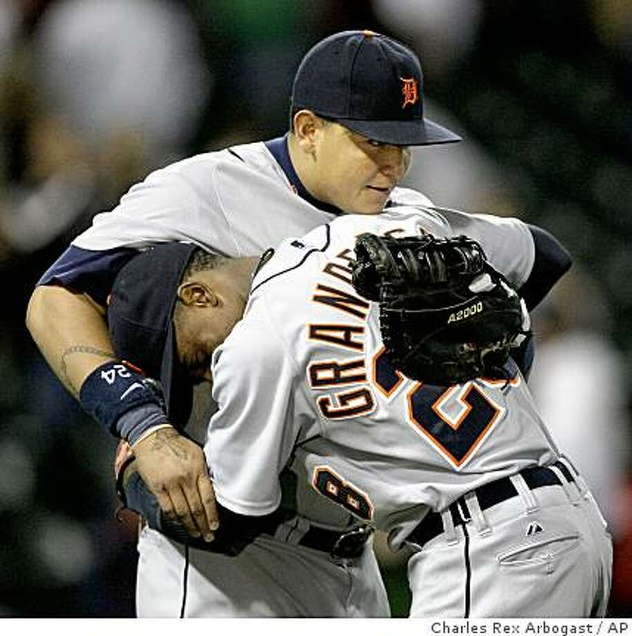 Detroit Tigers' Miguel Cabrera is hugged by Curtis Granderson after the Tigers defeated the Chicago White Sox 7-6 in 10 innings Tuesday, June 9, 2009, in Chicago. Cabrera hit a home run in the 10th inning. (AP Photo/Charles Rex Arbogast) Photo: Charles Rex Arbogast, AP