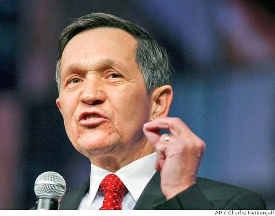 ** FILE ** Democratic presidential hopeful, Rep. Dennis Kucinich, D-Ohio, speaks during the Heartland Presidential Forum in this, Dec. 1, 2007, file photo in Des Moines, Iowa. Kucinich is abandoning his second bid for the White House, he said Thursday, Jan. 24, 2008, in an interview with Cleveland's Plain Dealer newspaper,and would make a formal announcement Friday. (AP Photo/Charlie Neibergall, File) Photo: Charlie Neibergall