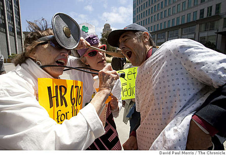 (L-R) Gail Sredanovic, 71, Menlo Park, Ruth Robertson, 57 from Palo Alto and Paul Kangas, 69 from San Francisco have some fun as they take part in a protest out in front of the United States Federal Building where House Speaker Nancy Pelosi's San Francisco office is located May 29, 2009 in San Francisco, Calif.  (Photograph by David Paul Morris/The Chronicle) Photo: David Paul Morris, The Chronicle