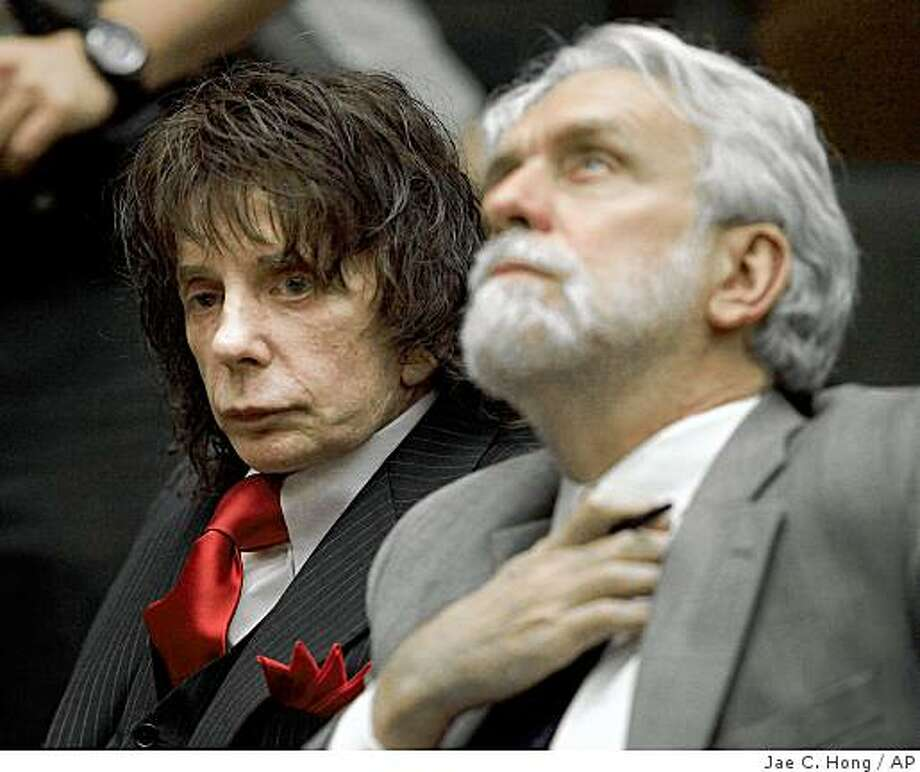 Music producer Phil Spector, left, and his attorney Dennis Riordan appear in a courtroom for Spector's sentencing in Los Angeles, Friday, May 29, 2009. Spector has been sentenced to 19 years to life in prison for the murder of actress Lana Clarkson. (AP Photo/Jae C. Hong, Pool) Photo: Jae C. Hong, AP