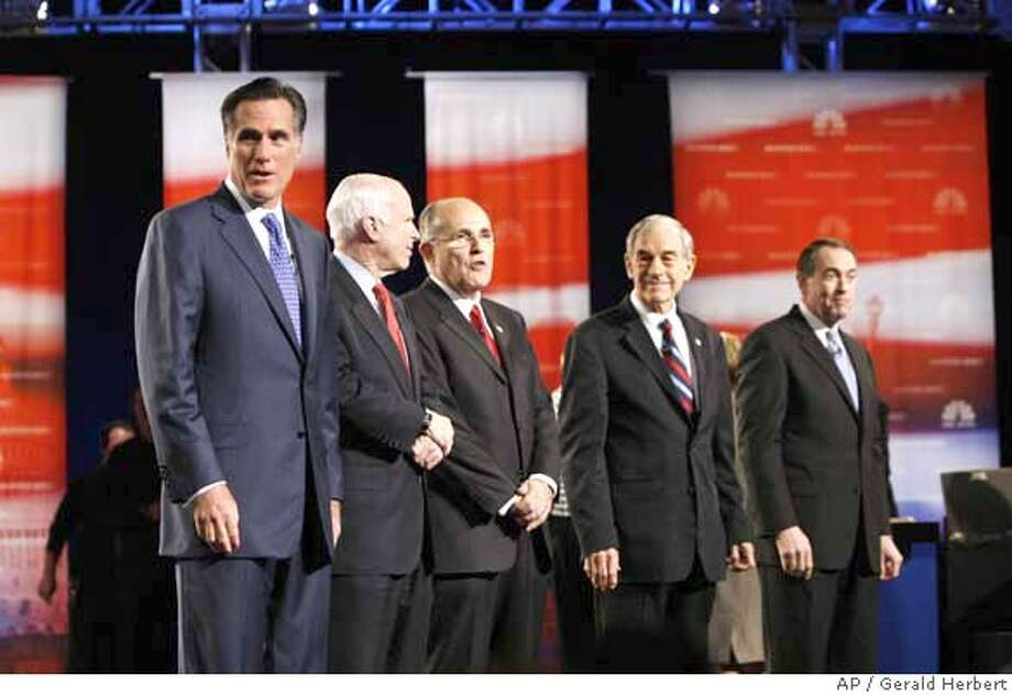 Republican presidential hopefuls line up on stage prior to the start of their debate at Florida Atlantic University in Boca Raton, Fla. Thursday, Jan. 24, 2008. Left to right are former Massachusetts Gov. Mitt Romney, Sen. John McCain, R-Ariz., former New York City Mayor Rudy Giuliani, Rep. Ron Paul, R-Texas, and former Arkansas Gov. Mike Huckabee. (AP Photo/Gerald Herbert) Photo: Gerald Herbert