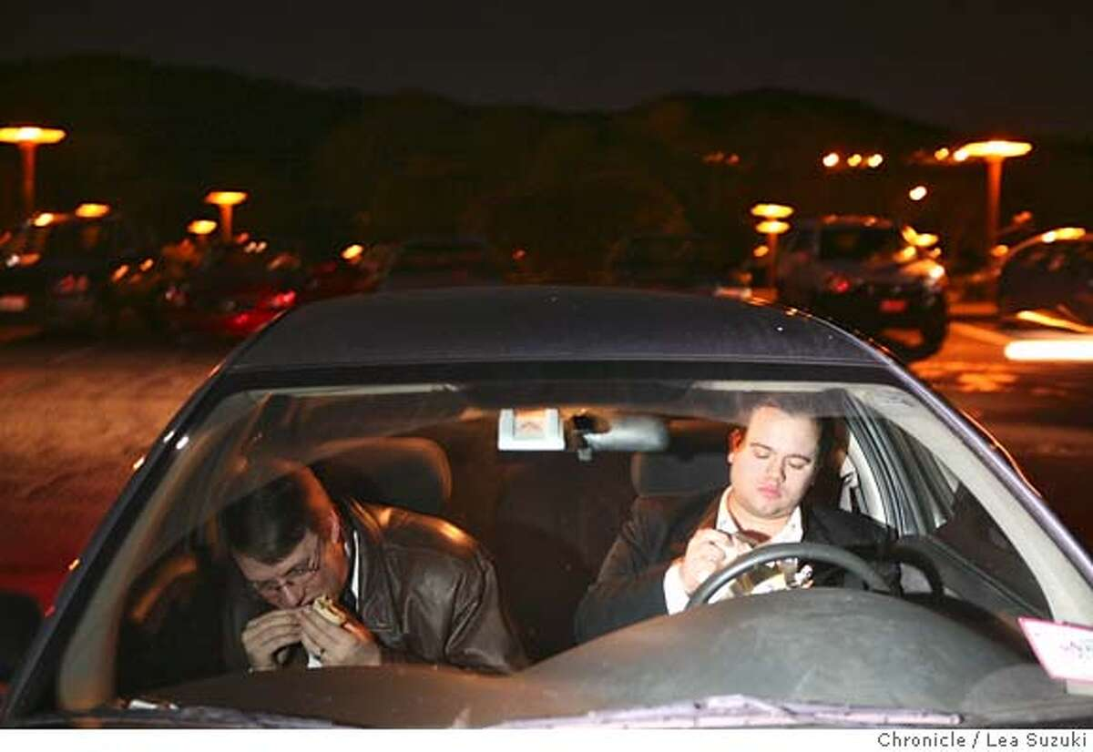 From left: Trombonist Bruce Chrisp and French Hornist Darby Hinshaw eat their dinner in Hinshaw's car before their gig with the Marin Symphony. Chrisp appears in the movie