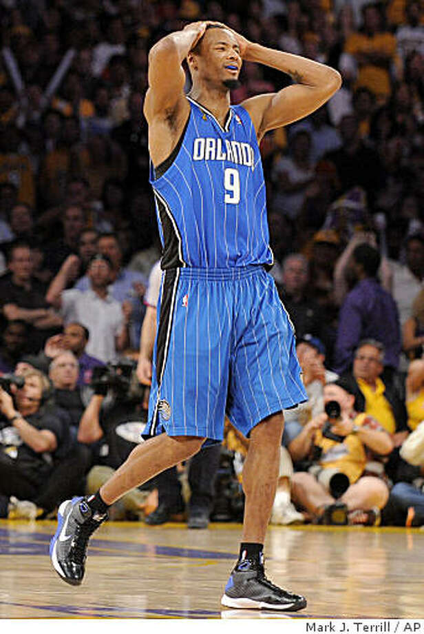 Orlando Magic forward Rashard Lewis (9) reacts after teammate Courtney Lee missed a shot at the buzzer during the second half of Game 2 of the NBA basketball finals aginst the Los Angeles Lakers Sunday, June 7, 2009, in Los Angeles.  (AP Photo/Mark J. Terrill) Photo: Mark J. Terrill, AP