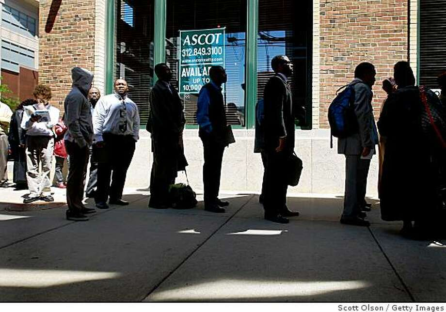 CHICAGO - JUNE 04:  Job seekers wait in line for a job fair June 4, 2009 in Chicago, Illinois. The number of people collecting unemployment insurance dropped slightly for the first time in 20 weeks. The number of new jobless claims also fell.  (Photo by Scott Olson/Getty Images) Photo: Scott Olson, Getty Images