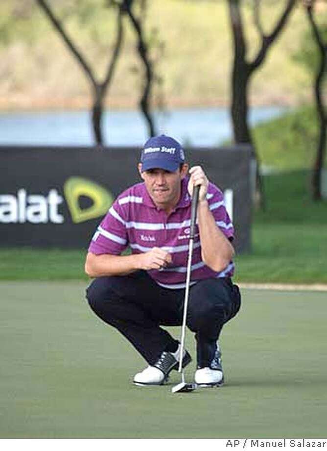 Irish golfer Padraig Harrington lines up a putt during the first round of the Abu Dhabi Golf Championship at the Abu Dhabi Golf Club on Thursday Jan. 17, 2008. (AP Photo/Manuel Salazar) Photo: Manuel Salazar