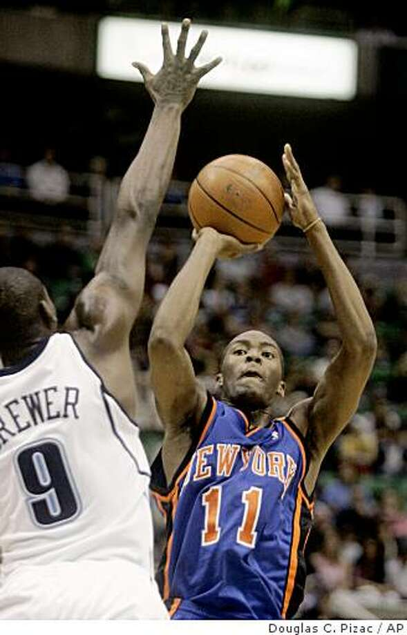 New York Knicks guard Jamal Crawford (11) shoots against Utah Jazz guard Ronnie Brewer (9) during the first quarter of the NBA basketball game Wednesday, Jan. 30, 2008, in Salt Lake City. Crawford finished the night with 26 points for the game-high and 9 assists. (AP Photo/Douglas C. Pizac) Photo: Douglas C. Pizac, AP