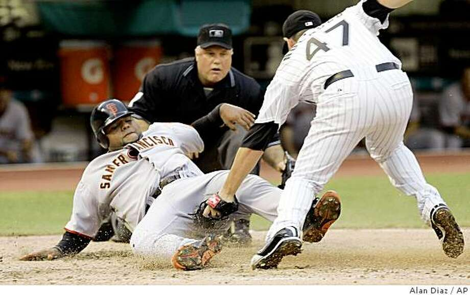 Florida Marlins' Ricky Nolasco (47) tags out San Francisco Giants' Pablo Sandoval, left, at home plate in the fourth inning of a baseball game as home plate umpire Brian O'Nora watches on Sunday, June 7, 2009, in Miami. (AP Photo/Alan Diaz) Photo: Alan Diaz, AP