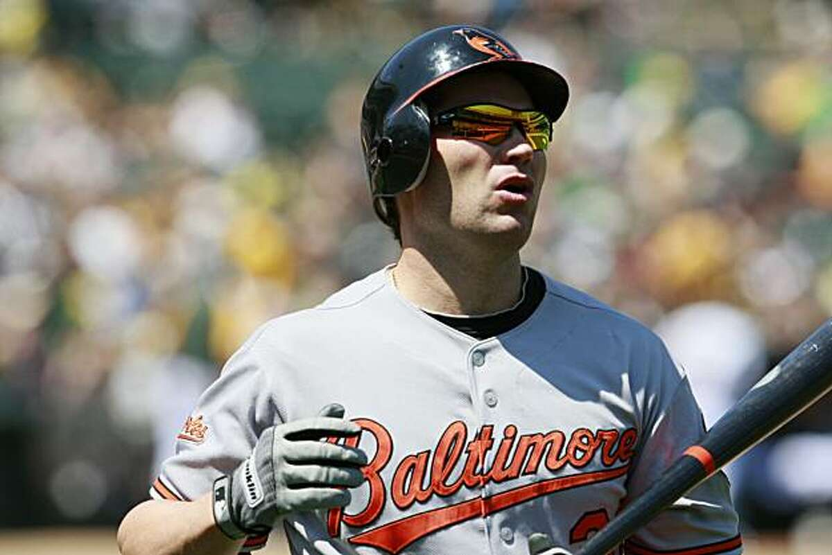 Orioles' Luke Scott reacts after striking out in the bottom of the sixth inning of the A's game versus Baltimore in Oakland on Sunday.