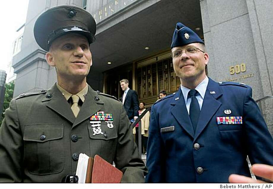U.S. military lawyers Marine Col. Jeffrey Colwell, left, and Airforce Major Rick Reiter, attorneys for Guantanamo detainee Ahmed Ghailani,  speak outside after Ghailani was arraigned at U.S. Federal Court in New York, Tuesday June 9, 2009.  (AP Photos/Bebeto Matthews) Photo: Bebeto Matthews, AP