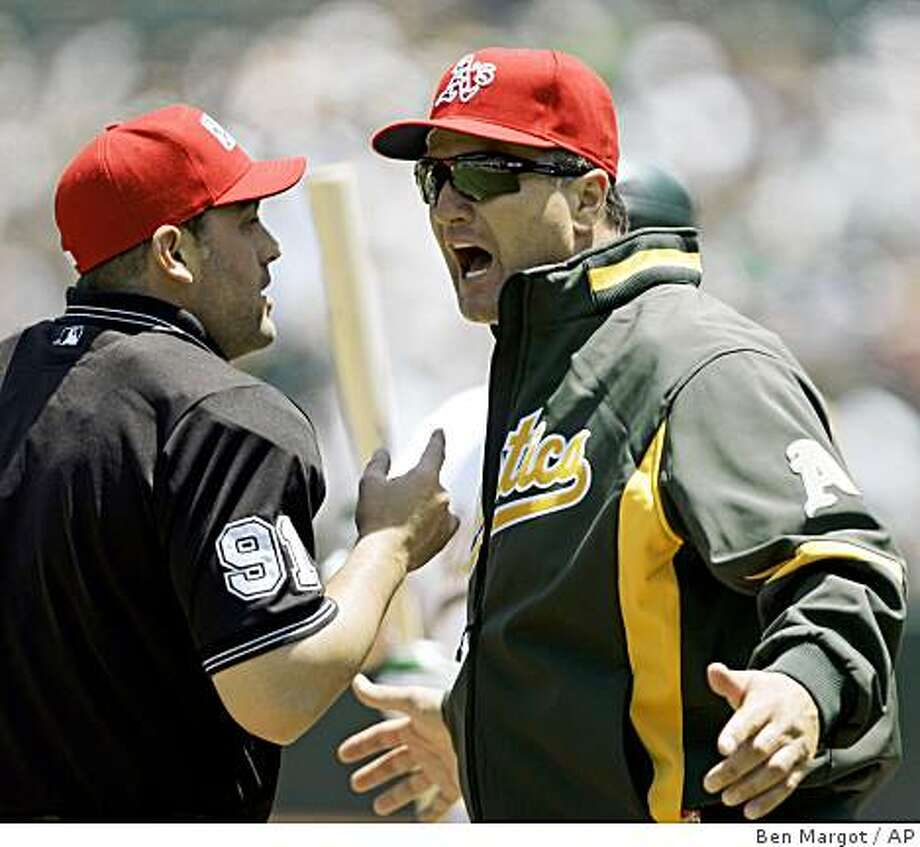 Oakland Athletics manager Bob Geren, right, argues the ejection of batting coach Jim Skaalen, not shown, with home plate umpire Brian Knight (91) in the first inning of a game against the Seattle Mariners on Monday, May 25, 2009, in Oakland, Calif. Photo: Ben Margot, AP