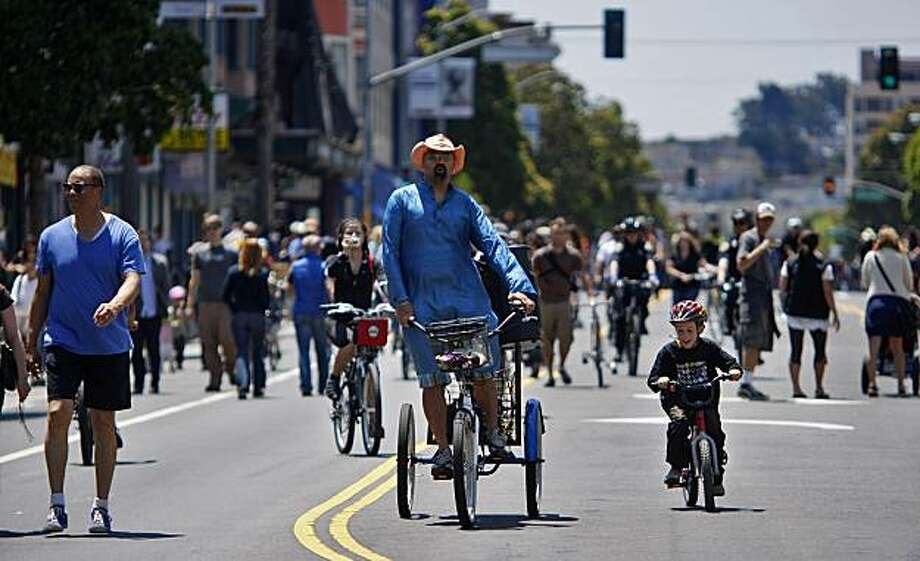 Bikers of all ages have fun listens to music and cruising down Valencia Street where Sunday Streets hits for the first time in the Mission, Sunday June 7, 2009, in San Francisco, Calif. Photo: Lacy Atkins, The Chronicle