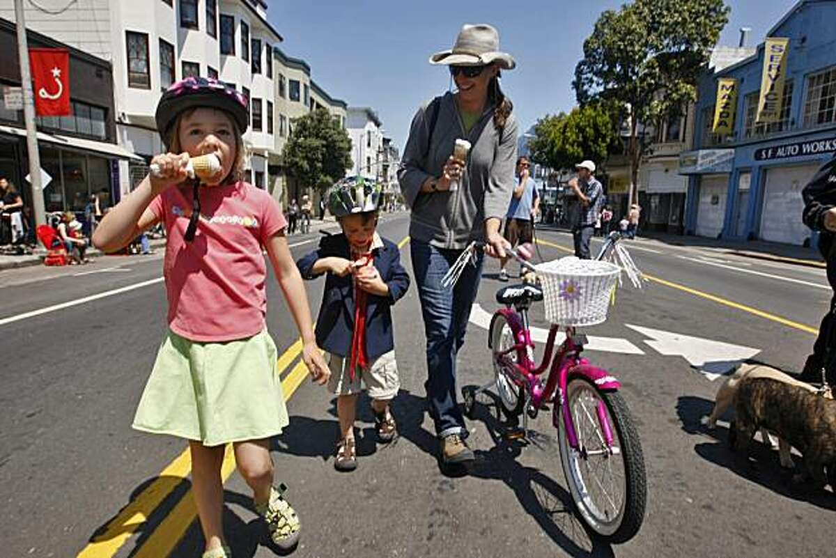 Ella and Wyatt Drennan enjoy some ice cream as they walk with their mom Kate Bickert down Valencia Street, Sunday June 7, 2009, in San Francisco, Calif.