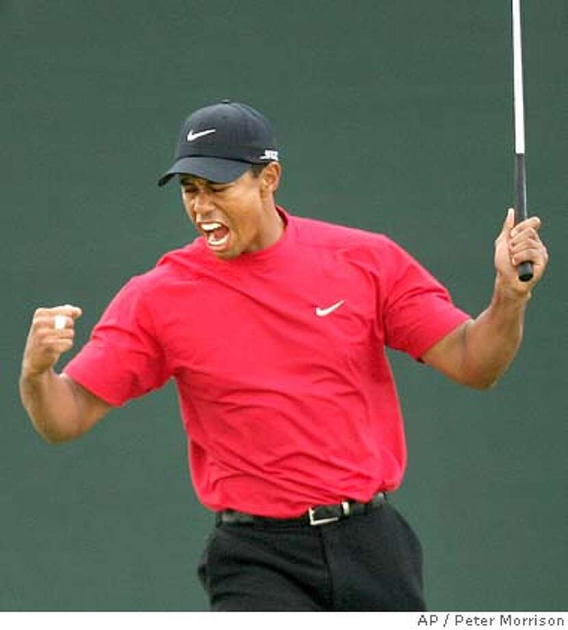 Tiger Woods of the United States reacts after putting a birdie on the 18th to win the Dubai Desert Classic golf tournament in Dubai, United Arab Emirates, Sunday, Feb. 3, 2008. (AP Photo/Peter Morrison) Photo: Peter Morrison