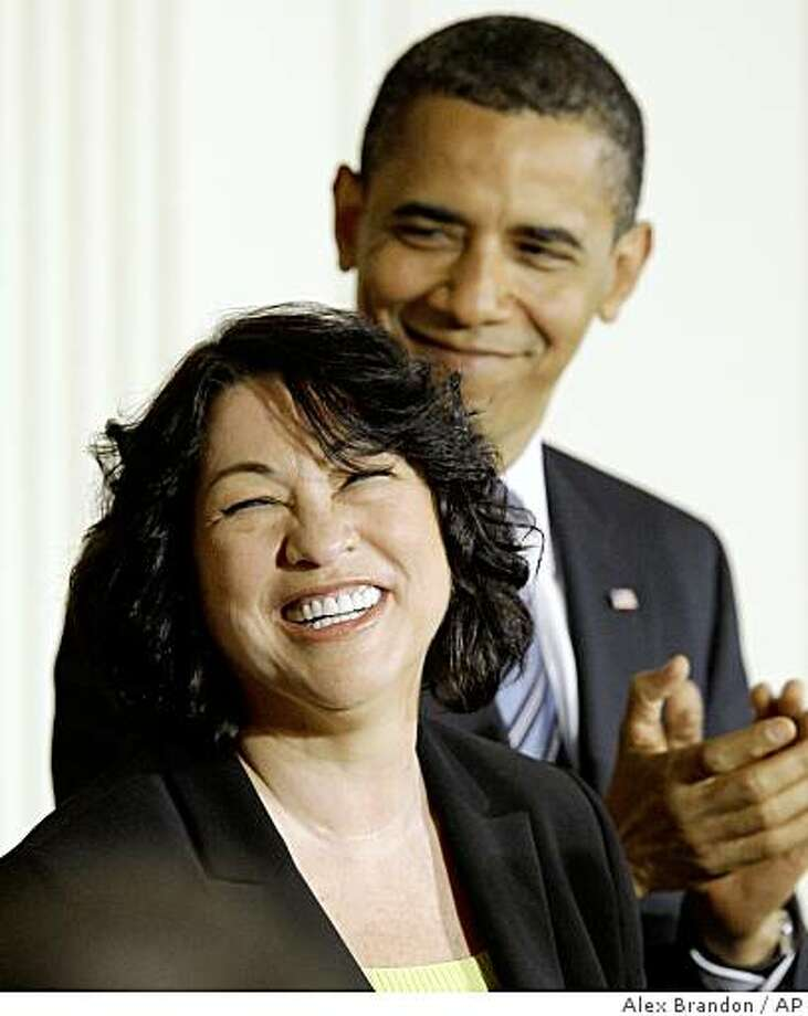 Supreme Court nominee Judge Sonia Sotomayor smiles as President Barack Obama applauds, Tuesday, May 26, 2009,in the East Room Ceremony of the White House in Washington. (AP Photo/Alex Brandon) Photo: Alex Brandon, AP