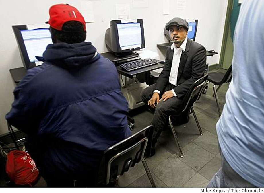 """David Hernandez, 29, checks his email for job leads at the Central City Hospitality House, a homeless drop in center that slated to close August 1st if Mayor Newsom's budget plan passes, on Mondya June 1, 2009 in San Francisco, Calif. Hernandez who has been homeless for the past 8 months, said, """"I have nobody. This is my family right now."""" Photo: Mike Kepka, The Chronicle"""