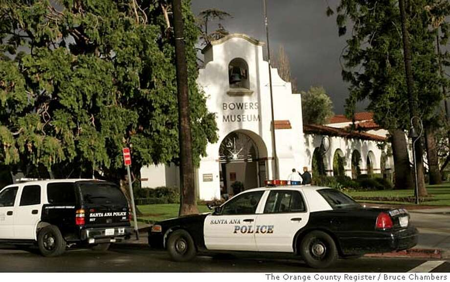 Early Thursday morning, Jan. 24, 2008, dozens of federal agents and Santa Ana Police served a search warrant at the Bowers Museum in Santa Ana, Calif., closing the facility and guarding each entrance. Federal agents raided several Southern California museums on Thursday in search of Southeast Asian antiquities that are believed to have been illegally obtained, smuggled into the U.S. and sold at inflated prices so sellers could claim fraudulent tax deductions after donations to the institutions. (AP Photo/The Orange County Register, Bruce Chambers) **LA TIMES OUT, NO SALES, MAGS OUT** LA TIMES OUT, NO SALES, MAGS OUT Photo: Bruce Chambers